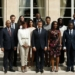 French President Emmanuel Macron (C) poses with members of the new Presidential Council in charge of Africa at the Elysee Palace in Paris, on August 29, 2017. (Photo by YOAN VALAT / POOL / AFP)